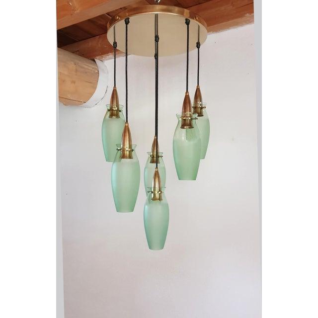 Large brass & green glass flush mount pendant light. Mid Century Modern, in the style of Arredoluce, Italy, circa 1960s....