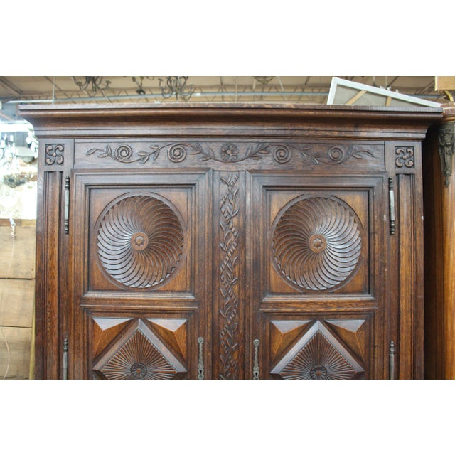 Stunning late 1700's French antique armoire/wardrobe. Highly carved with bold and handsome symmetry, this piece is truly...