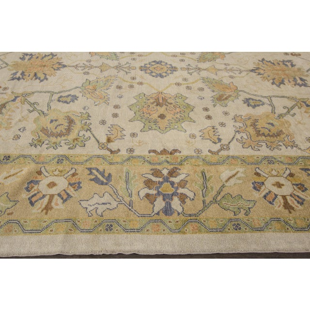 Hand-knotted rug with a floral design on a beige field with green borders. This rug has magnificent detailing and would be...