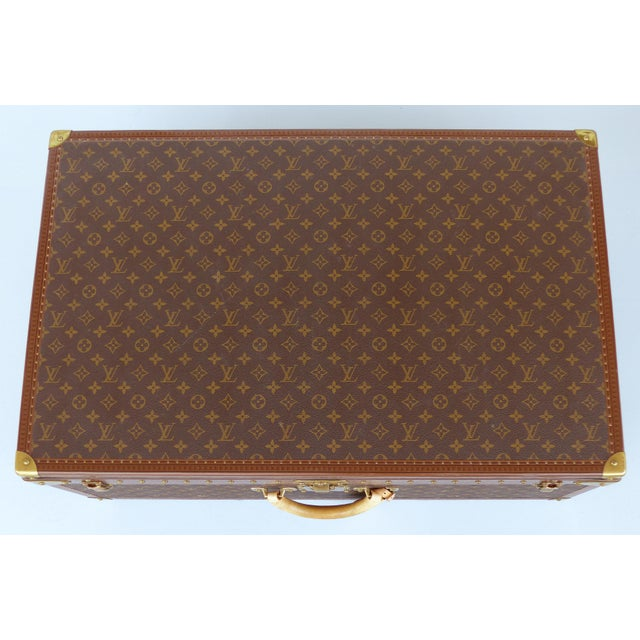 Offered for sale is a Louis Vuitton hard-sided leather Alzer 80 suitcase. The largest of this model, this beautifully...