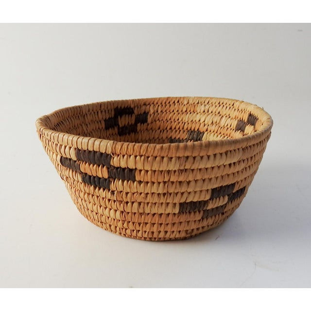 Small coiled grass Papago Native American basket. Nice color variation with dark brown accents.