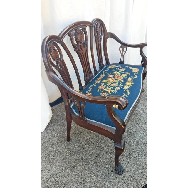 This is a gorgeous settee made of mahogany in the chippendale style. The seat cushion has been upholstered with an...