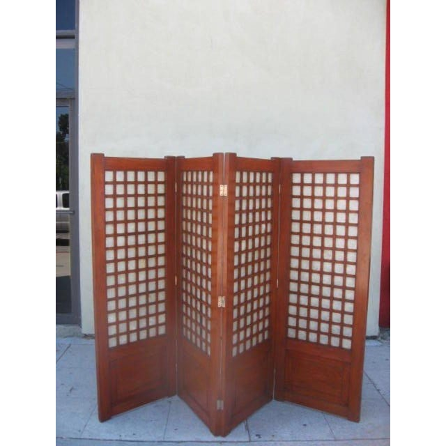 Four panel screen with a mahogany frame and abalone inserts..