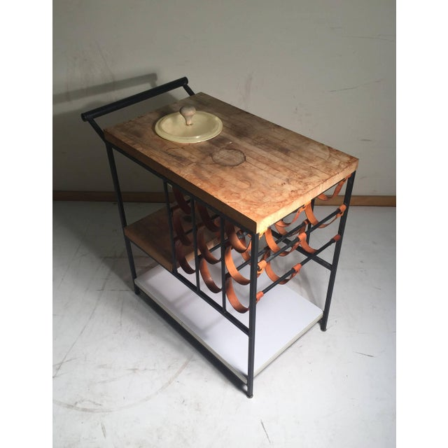 Beautiful example of Arthur Umanoff's bar cart with leather strap wine rack. Butcher blocks need to be sanded down. Cart...
