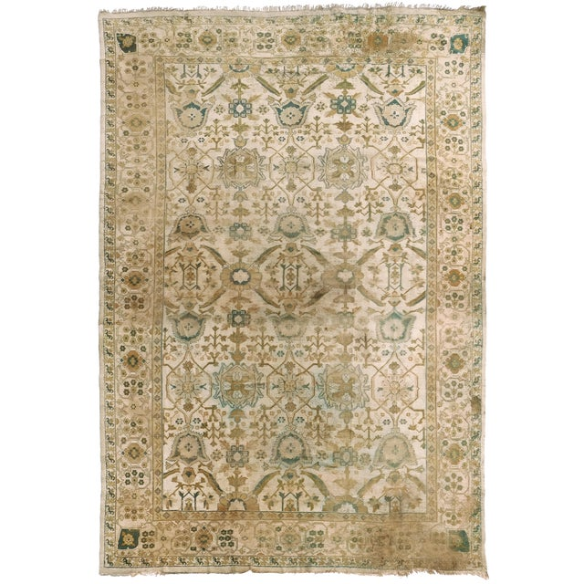 Distressed Antique Hand Knotted Indo-Oushak Rug - 12′ × 17′6″ For Sale
