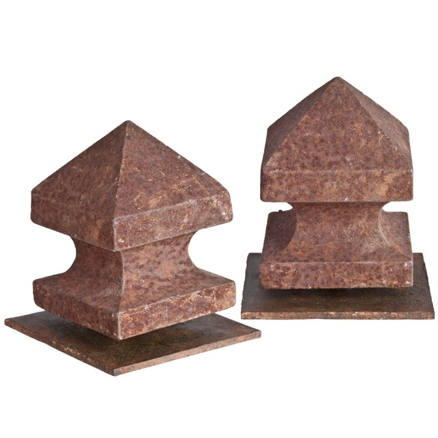 Pair of vintage square rustic metal post finials, mounted on reclaimed iron stands for display.
