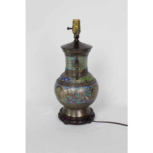 Champleve Table Lamp, Two handled urn form. Worn finish with design of dragons and flowers.