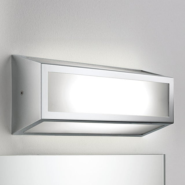 Polished chrome bathroom wall light which can be mounted vertically or horizontally. IP44 rated with a light diffuser. We...