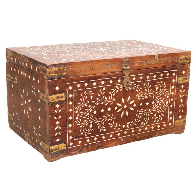 Warm worn wood, simple yet elegant floral designs, this storage box contains ample space for storing small items, stands...