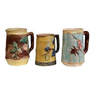 Set of Three French 19th Century Hand-Painted Ceramic Barbotine Pitchers