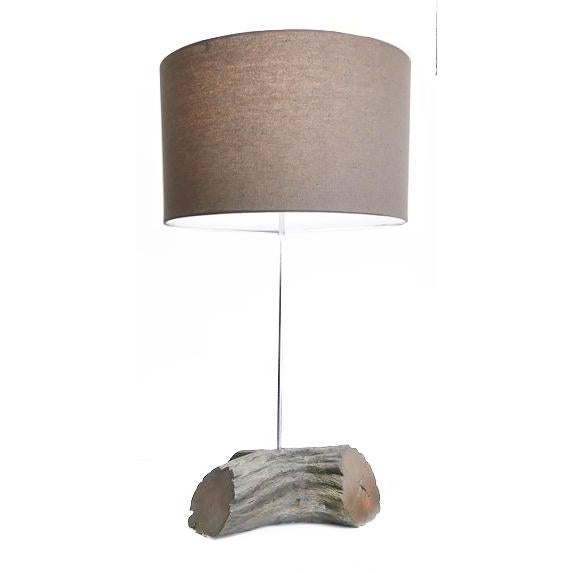 Lamp made from a wood branch. It is probably from the 70s. There is a dark finish added. This is the perfect lamp for your...