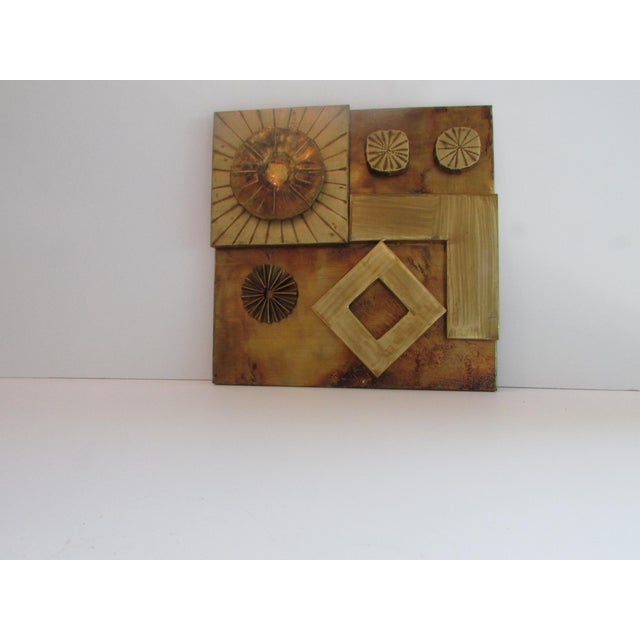 In the brutalist style of C. Jere a brass multi layered/texture wall plaque from the 1970's.
