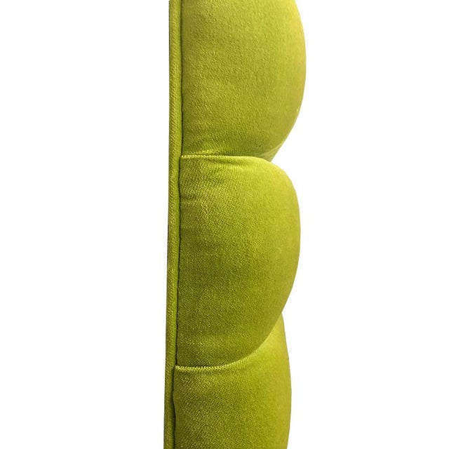 Green mid-century modern wall-mountable velvet channeled headboard. The backing is made of wood and has no hardware....