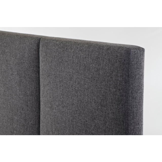 The Hewes Headboard is tailored with a slim silhouette. It has been upholstered in a woven fabric, making it a perfect fit...
