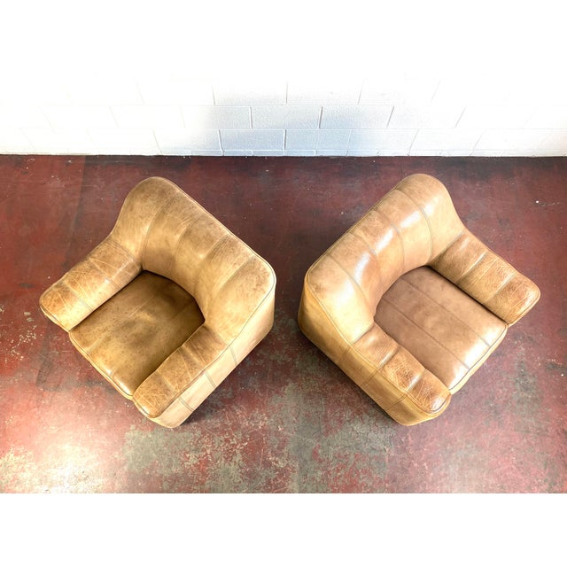 Pair of De Sede leather lounge chairs, model DS 44. Retractable seat adds 7 inches of depth.