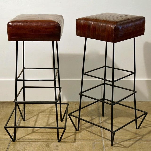Frederick Weinberg EEL Skin Stools. This listing is for a pair of wrought iron and EEL skin bar stools C. 1970's....