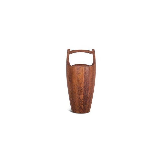 Midcentury Danish ice bucket in solid teak. The wood shows a beautiful grain and provides this object with a nice, elegant...