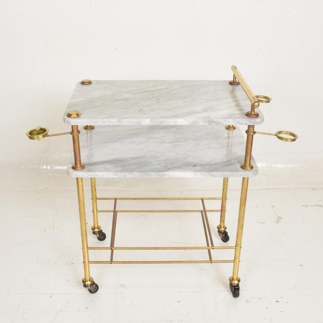 For your consideration, a mid century modern bakery service table In carrara marble and brass. Made in Mexico circa the...