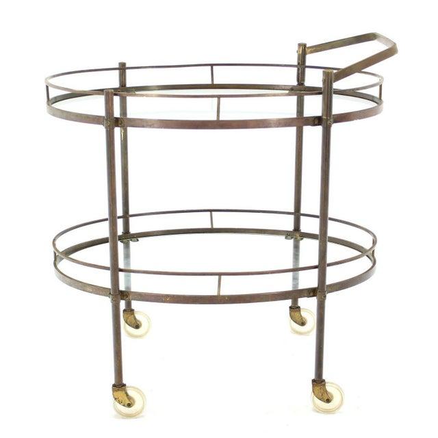 Nice brass and brass serving cart.