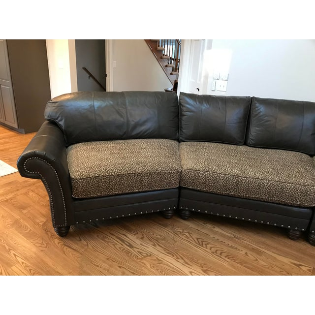 This traditional yet contemporary sectional is covered in a warm dark gray leather. In warm light it reveals a hint of...