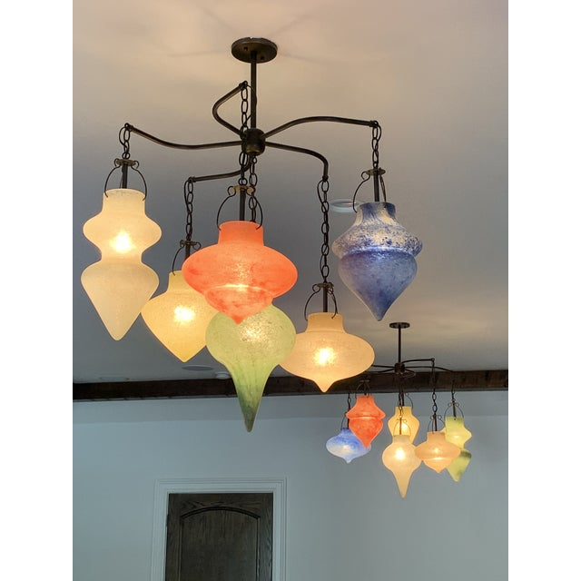 Two Italian 5-Arm Scavo Chandeliers with center diffusers. This pair of chandeliers was purchased new and immediately...
