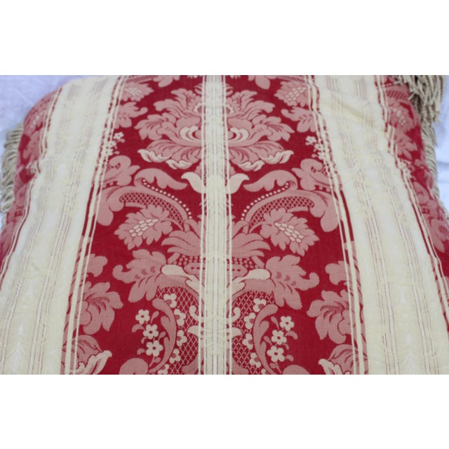 Elegant Italian silk down pillow in dark red and cream with 3-inch silk rope fringe.