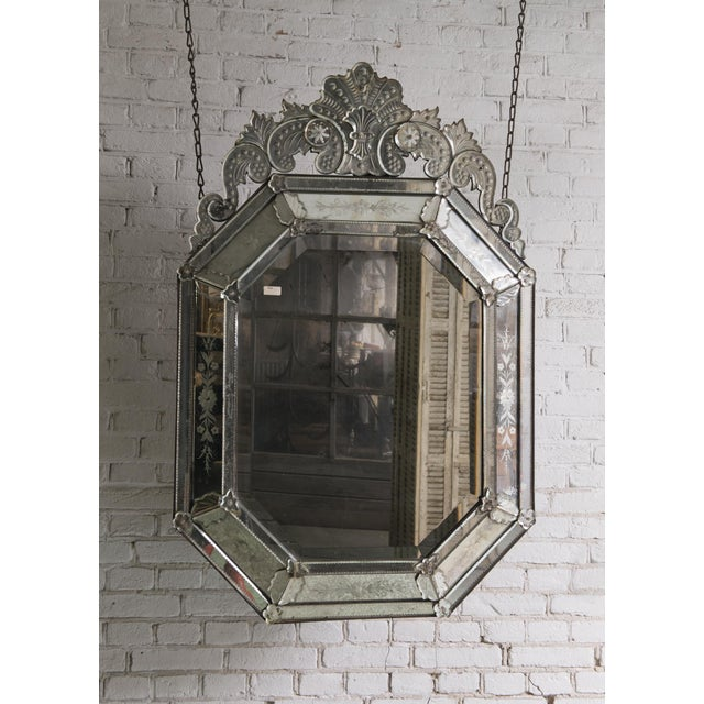 19th century Venetian mirror, with its original mirror-glass, Provenance Italy This 19th Century Mirror is adorned with...