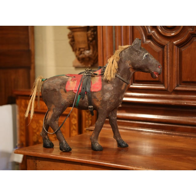 Interesting antique horse sculpture from France; crafted, circa 1870, the sculpture features a hand-painted horse made of...