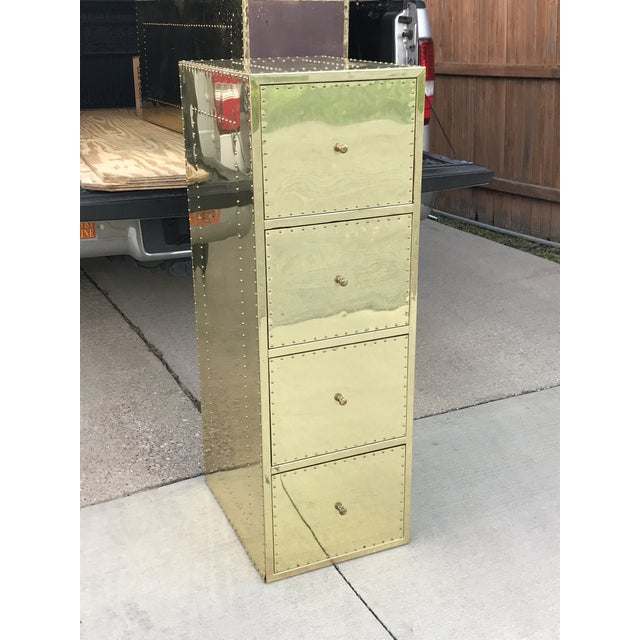 Wonderful vintage file cabinet covered in brass with brass nail head stud trim. In the style of Sarried LTD.
