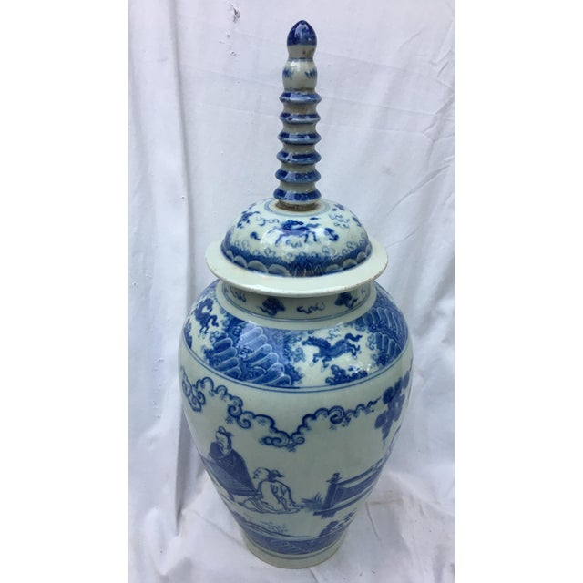 Fabulous blue-and-white porcelain vase with amazing spiral handle lid. Features intricate hand-painted Chinese motif....