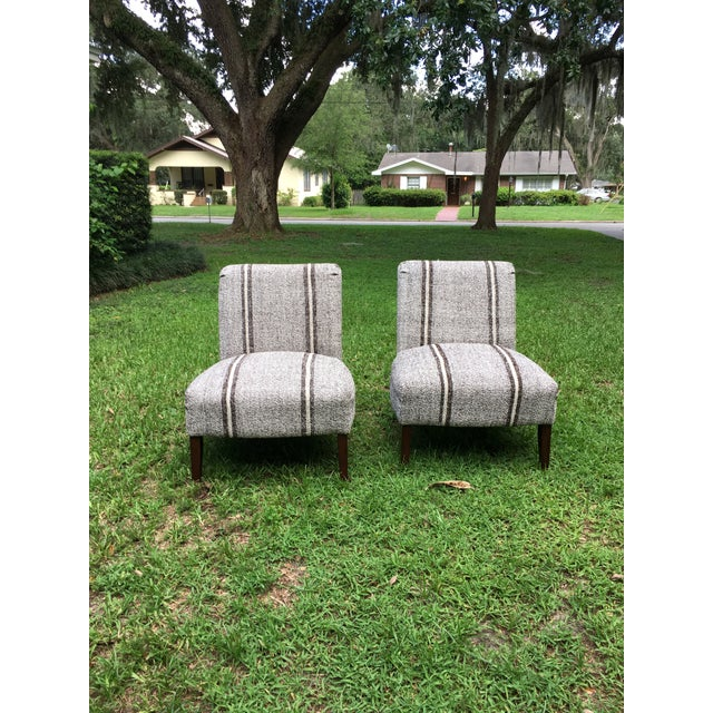Pair of slipper chairs in great condition. These are an excellent pair of comfy chairs. I had them upholstered with a...