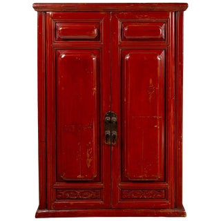 Chinese Red Cabinet With Doors and Hidden Drawers and Distressed Gold Accents For Sale