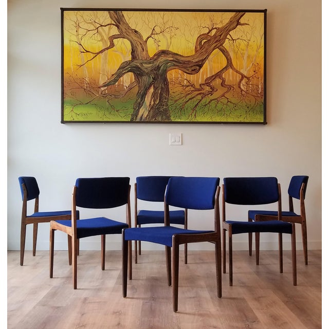 Here is a beautiful set of six Danish rosewood dining chairs in vibrant blue upholstery. The royal blue fabric compliments...