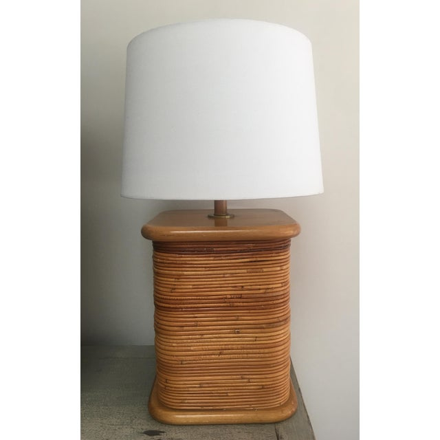 Vintage Mid-Century split reed / pencil reed bamboo lamp in the style of renowned Italian designer, Gabriella Crespi. The...