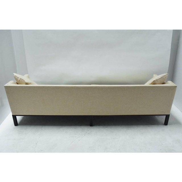 A good sofa by Edward Wormley for Dunbar, with dark walnut base and legs.