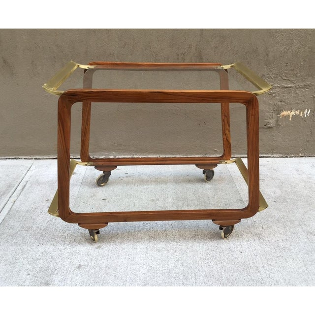 Austrian walnut and brass bar cart / trolley. Two-tier with clear glass shelves.
