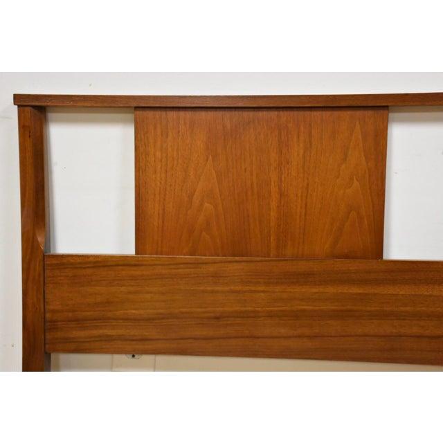 "A mid century modern full size headboard made of walnut. 56.5"" wide. 35"" tall."