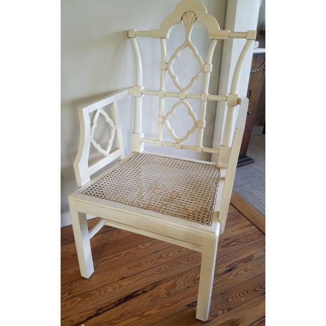Market found, I love the design and scale of this off white Chippendale arm chair with a cane seat from Furniture Classics...