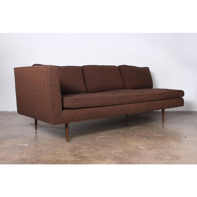 A one armed sofa or chaise with brass legs. Designed by Edward Wormley for Dunbar.