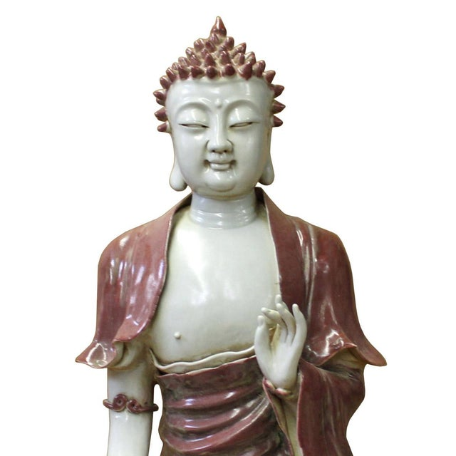 This is a handmade Chinese accent decorative porcelain statue of Buddha in off white and red vintage color. There are...