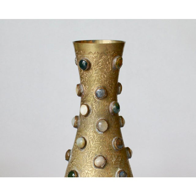 This vintage engraved brass vase with round onyx placed throughout the body, looks like a current design of today. The...