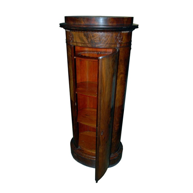 Mid Century pedestal cabinet from Denmark. Made of mahogany and in fine antique condition. Comes with a key.