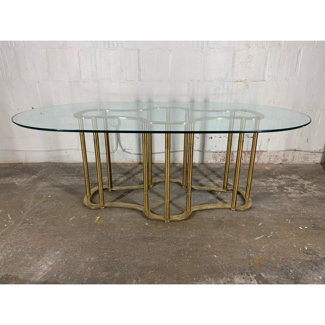 """Brass pedestal """"Racetrack"""" faux bamboo dining table by Mastercraft. Original glass top with beveled edge. Excellent..."""