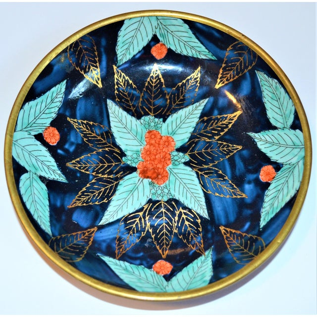 This is a beautiful vintage Asian indigo and turquoise blue and gold bowl. It is encased in a brass outer exterior. The...