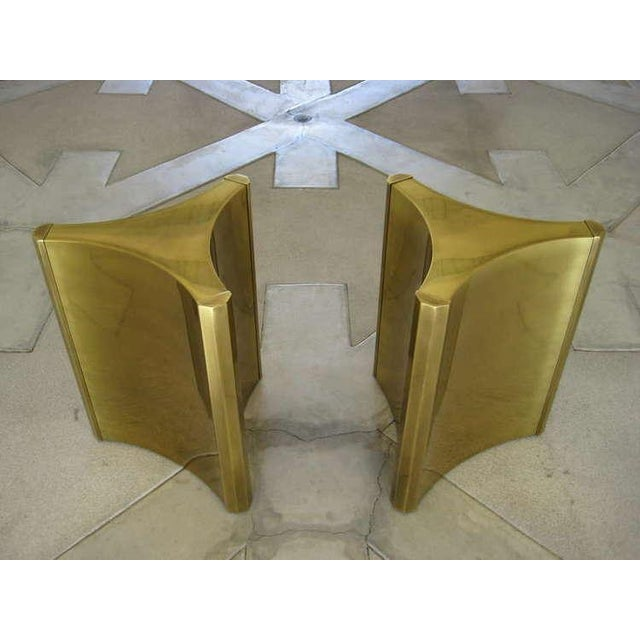"A pair of very stylish and highly sought after ""trilobi"" (three lobed) Mastercraft brass plated steel pedestal dining..."
