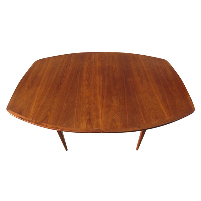 Vintage mid-century modern walnut extendable dining table. Attributed to Danish designer Kurt Ostervig. This table...