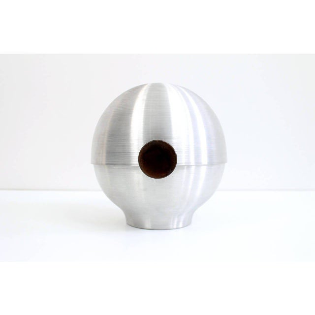 Early modernist spun aluminum vessel with tilting lid designed by Russel Wright for Metware. Originally marketed as a...