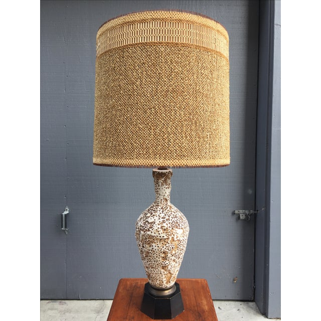 A ceramic glazed table lamp with a coral like texture and original Maria Kipp shade. Wonderful patina to wood base. In...