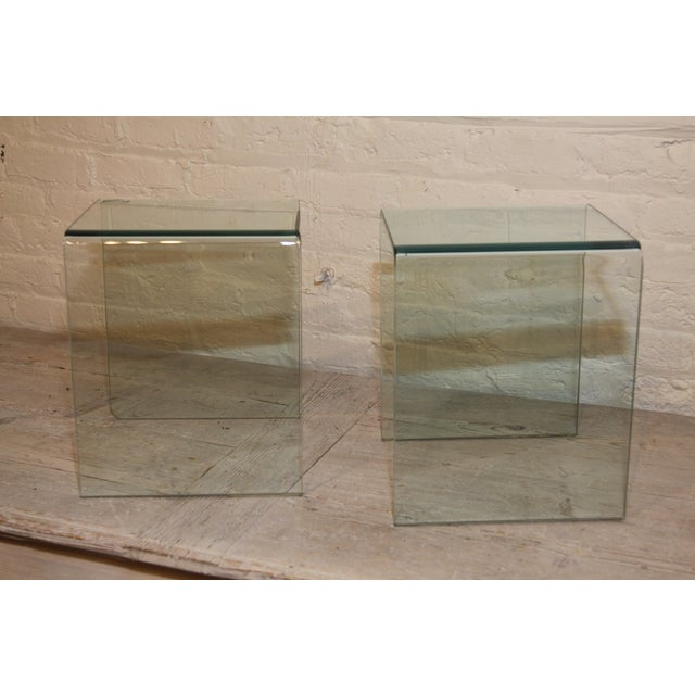 Fabulous pair of French 1980s glass waterfall side tables, discovered in the markets of Paris.