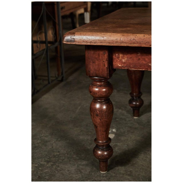 This impressive English table is called a scrub table, a term for tables that were used to prepare food. The table stands...